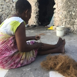 Diego's mom spinning coconut fiber against her leg. She made it look so easy!